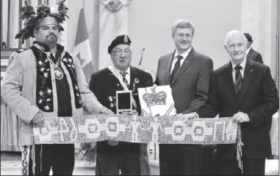 Anishinabek of Serpant River, Chief Isadore Day and Anishinabek Warrior Art Meawasige present backwards the 1764 Niagara Covenant Chain Belt as a protocol to Prime Minister Harper and the Governer General to demonstrate the outstanding issues that need to be adressed